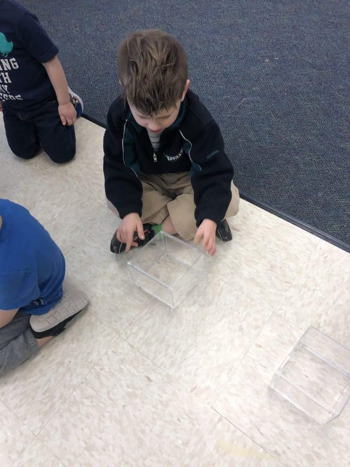 What Are Some Student-Centered Teaching Strategies child working on project on the classroom floor