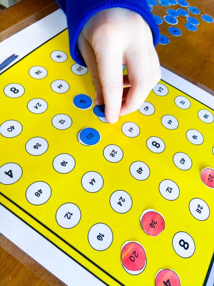 student playing multiplication find four